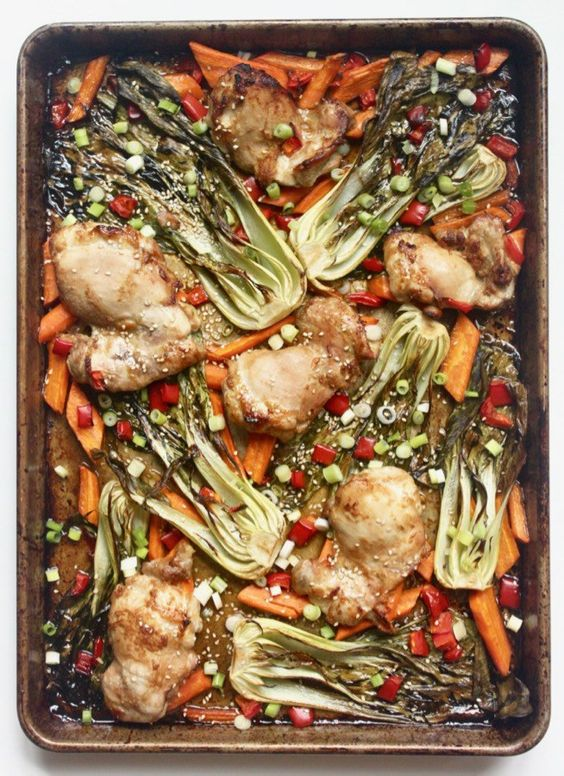 Everything you need for this Sesame Ginger Chicken and Vegetables meal cooks together on one sheet pan for easy clean up! This easy weeknight meal is a family favorite for good reason! Plus it's Whole30, paleo, gluten free, and dairy free!