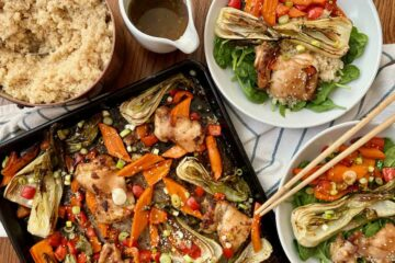 paleo sesame ginger chicken and vegetables sheet pan meal served with quinoa