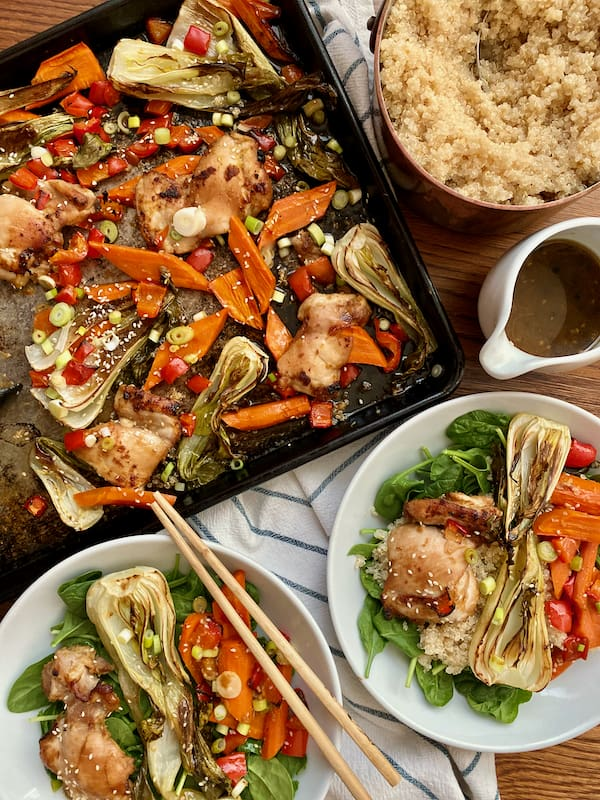 Gluten Free sesame ginger chicken and vegetables sheet pan meal served with quinoa