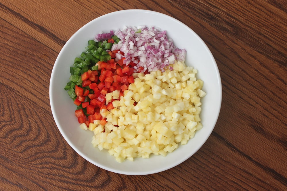 Whole30 pineapple pepper confetti salsa with red and green bell peppers