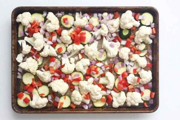 Vegetables are the base of this ginger turmeric chicken sheet pan meal