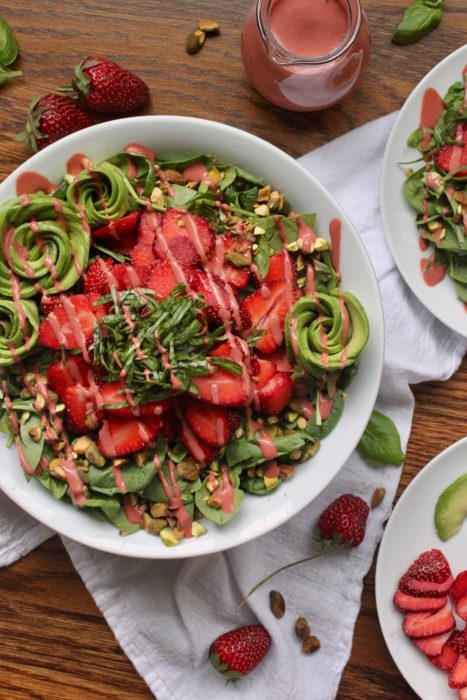 healthy strawberry avocado salad with pistachios and basil
