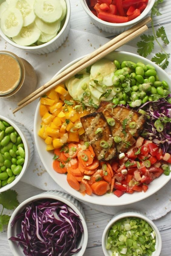 Healthy rainbow buddha bowls with oven baked crispy tofu