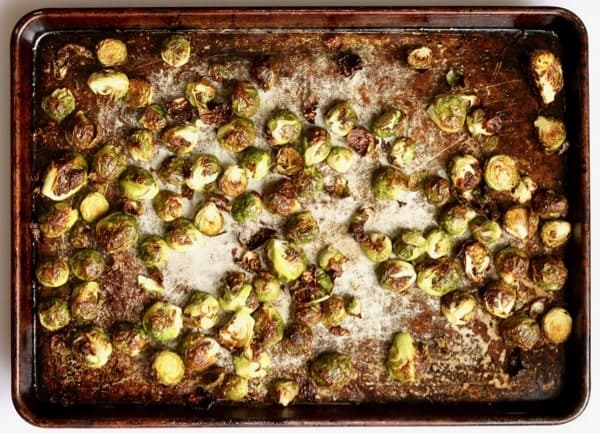 Perfectly roasted brussels sprouts ready to coat in pistachio sage relish