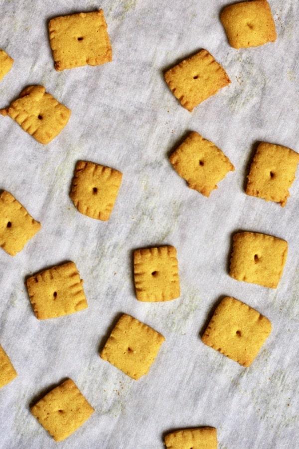 Homemade gluten free cheese crackers on a baking sheet