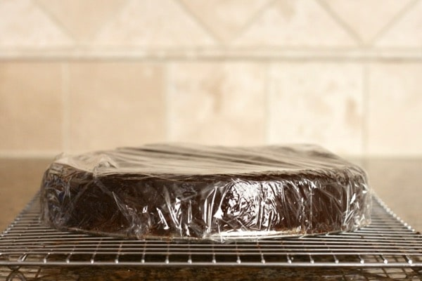 Paleo chocolate truffle cake wrapped in plastic wrap